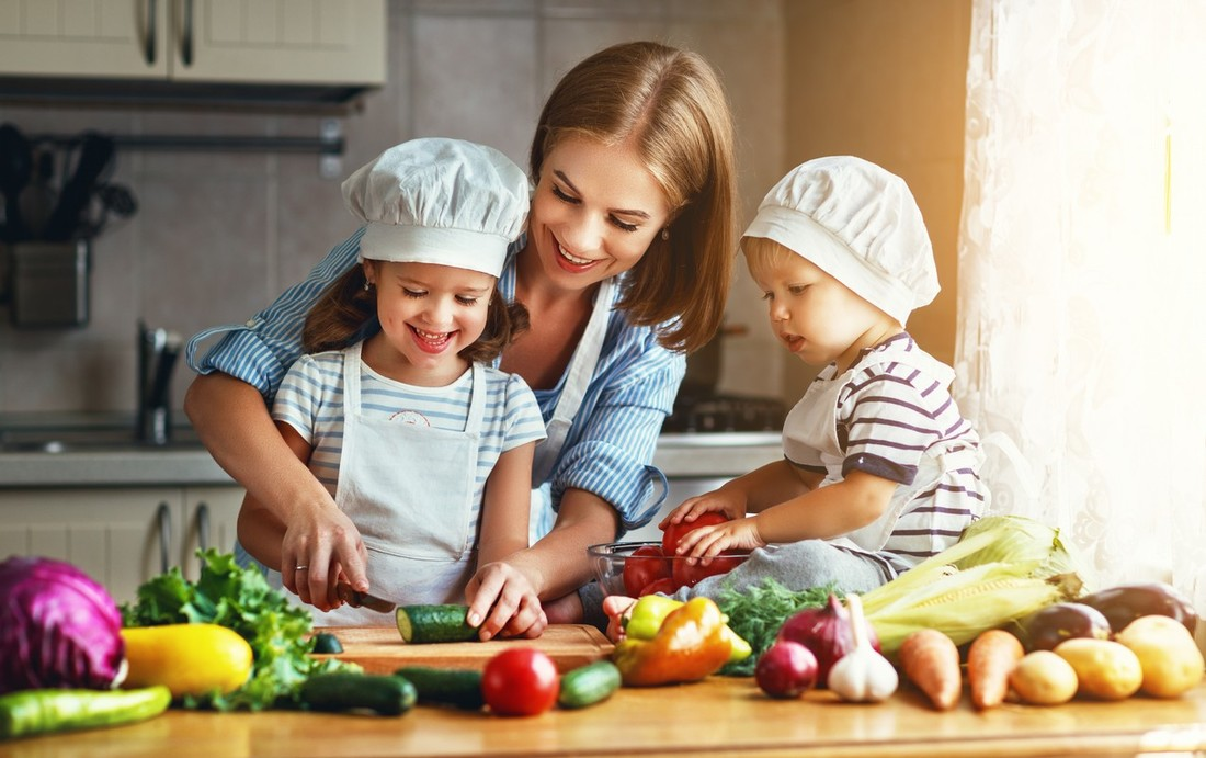 mother and children prepares vegetable salad
